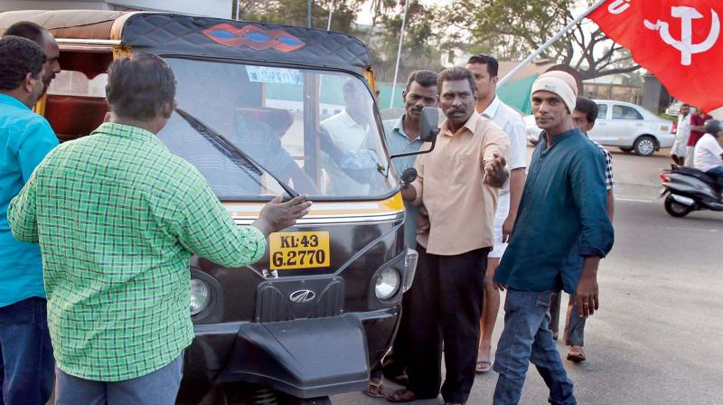 Protestors block an autorikshaw at the entrance of Willingdon Island in Kochi on Tuesday in connection with the two-day nation-wide general strike.