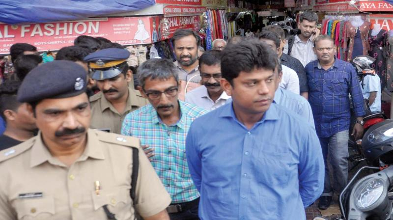 Ernakulam District Collector Mohammad Y Safirulla visits the shops at Convent Junction during  the two-day nationwide general strike, in Kochi on Tuesday (Photo: SUNOJ NINAN MATHEW)