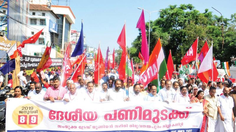 Members of Central Trade Unions take out a march to Secretariat in support of the nation wide strike on January 8 and 9, in Thiruvananthapuram on Tuesday.