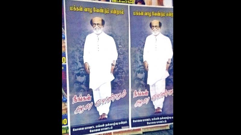 Super star Rajinikanth supporters put up posters on Anna Salai on Thursday, requesting the actor to enter politics. (Photo: DC)