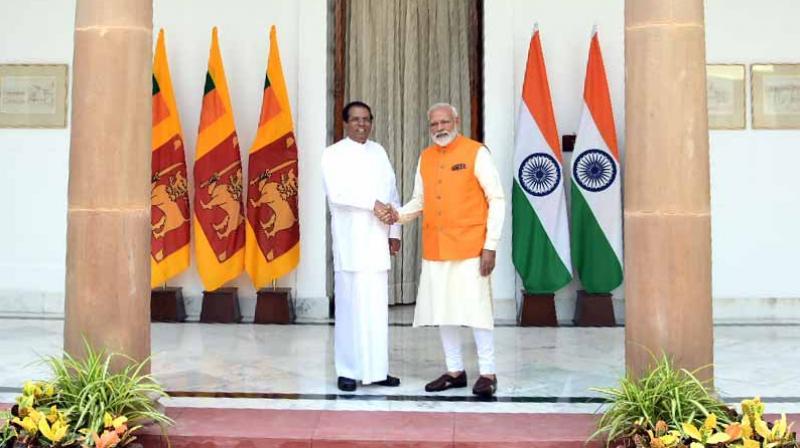 Prime Minister Narendra Modi meets up with Sri Lankan President Maithripala Sirisena. (Photo: ANI)