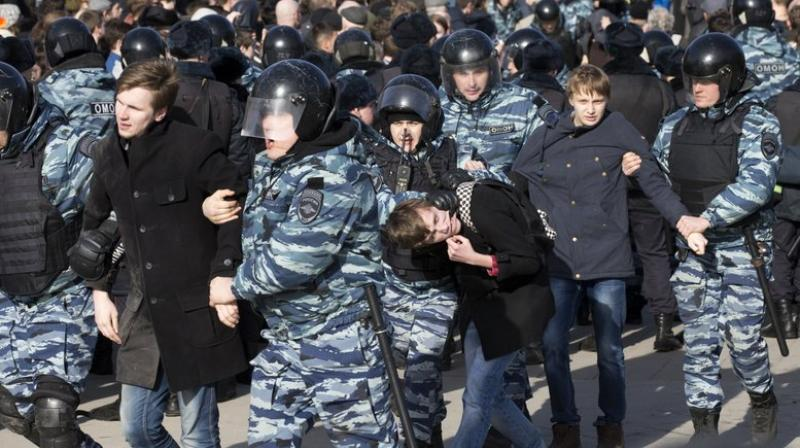 Police detain young protesters in downtown Moscow, Russia (Photo: AP)