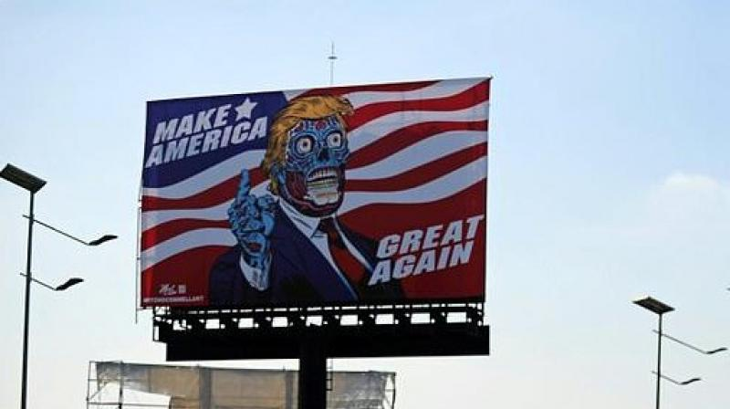 "A billboard by US artist Mitch O'Connell depicting President Donald Trump displayed in Mexico City is in allusion and tribute to John Carpenter's 1988 cult movie ""They Live"". (Photo: AFP)"