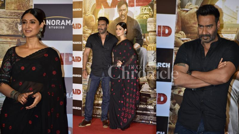 Bollywood star Ajay Devgn's upcoming thriller 'Raid' trailer released today. Check out some interesting pictures from the event. (Photos: Viral Bhayani)