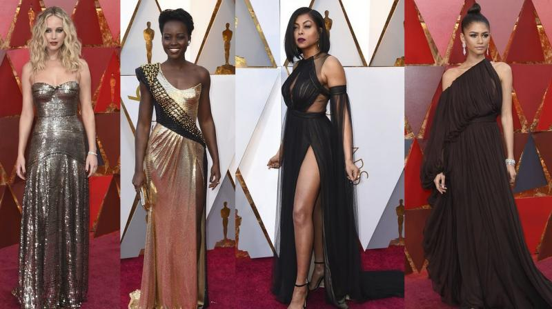 See all the exclusive pictures of celebrities on the red carpet at the 90th Academy Awards. (Courtesy: AP Photos)
