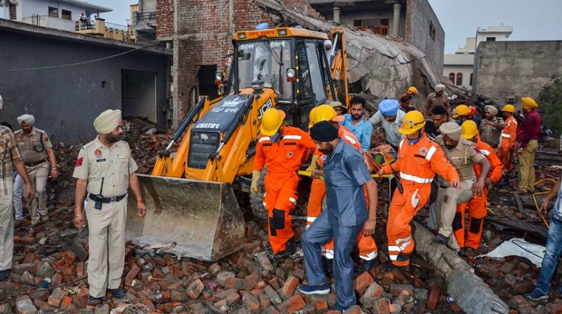 Teams of the National Disaster Response Force or NDRF and the State Disaster Response Force or SDRF were aiding rescue operations.  (Photo: PTI)