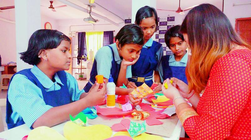 Art for the heart: Students of Ashray Akruti work on an art project. (Photo: DC)