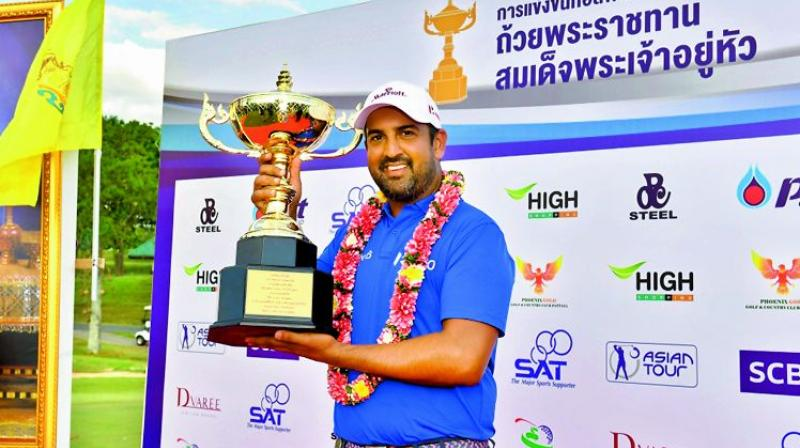Shiv Kapur poses with the trophy after winning the Royal Cup in Pattaya, Thailand, on Sunday. It was Shiv's third Asian Tour title of the year.