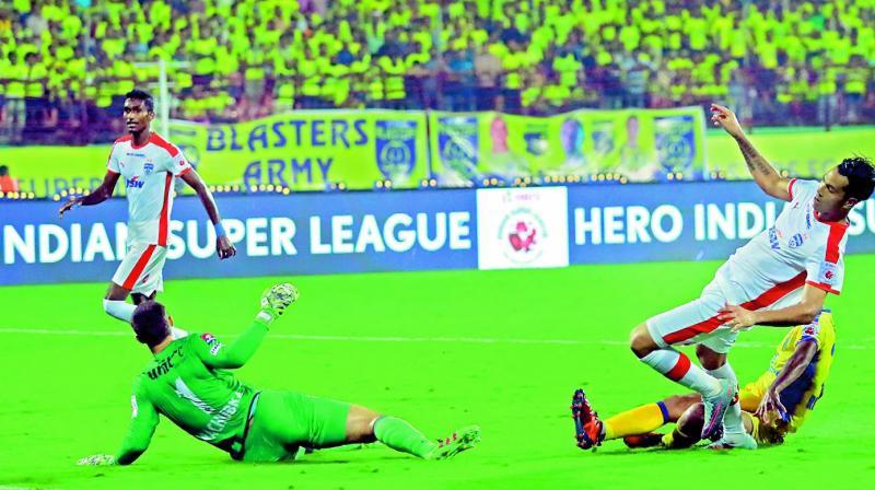 Bengaluru FC's Miku scores against Kerala Blasters in their ISL match in Kochi on Sunday. (Photo: ARUNCHANDRA BOSE)
