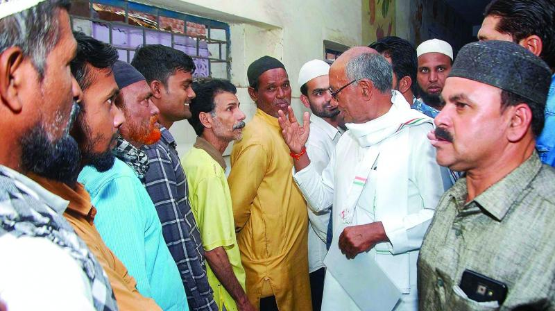 Congress candidate from Bhopal seat Digvijay Singh interacts with voters in Bhopal on Sunday (Photo: AP)