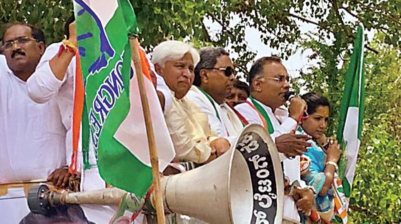 Congress leaders H.K. Patil, Siddaramaiah, Dinesh Gundurao and party's Kundgol candidate Kusuma Shivalli on their way to file papers in Kundgol on Monday