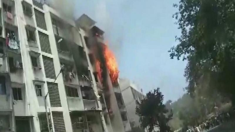 Two people were injured in a fire that broke out on the fourth floor of Sarita building at Mazil Masjid Chowk in Andheri's Yari Road area here on Sunday. (Photo: ANI)