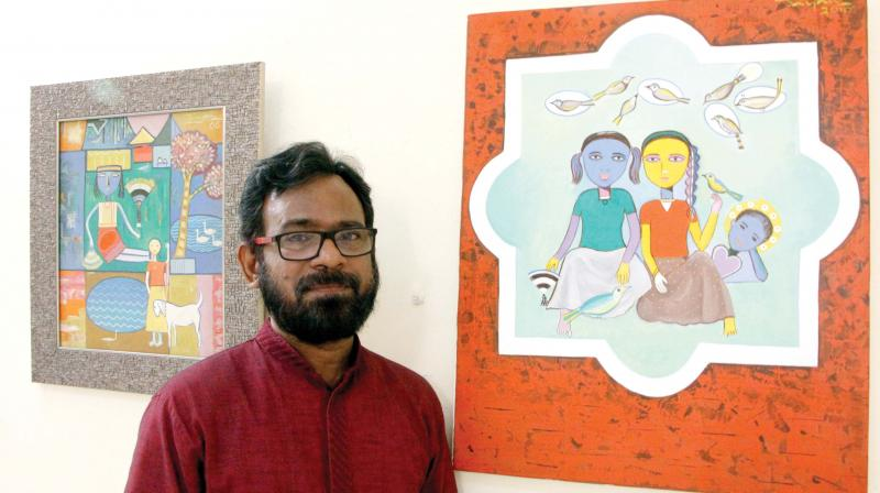 Artist C.D. Jain with his painting