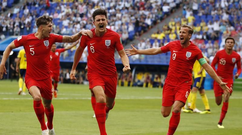 Harry Maguire celebrates with teammates after giving England the lead. (Photo: AP)