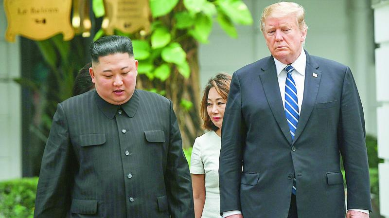 US President Donald Trump (R) walks with North Korea's leader Kim Jong Un during a break in talks at the second US-North Korea summit at the Sofitel Legend Metropole hotel in Hanoi on Thursday. (Photo: AFP)