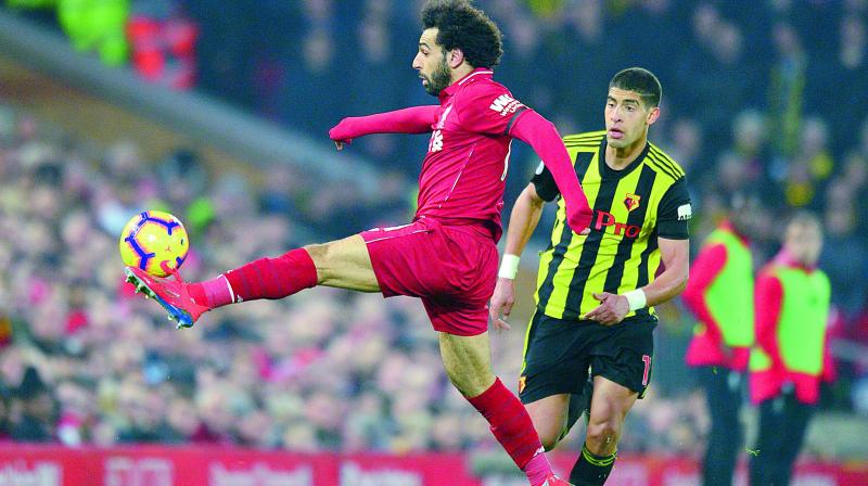 Liverpool's Egyptian midfielder Mohamed Salah controls the ball during their English Premier League football match against Watford at Anfield in Liverpool on Wednesday. Liverpool won 5-0. (Photo: AFP)