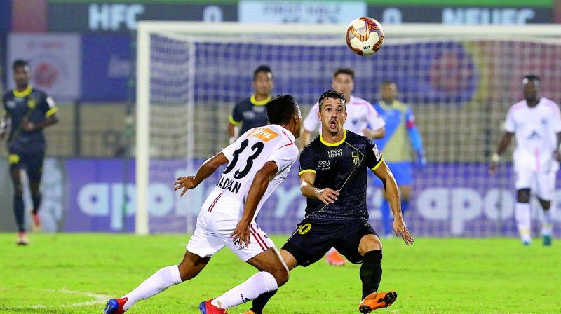 Action from the ISL match between Hyderabad FC and NorthEast United FC in Hyderabad on Wednesday.