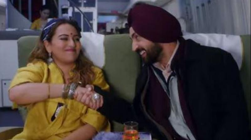 Sonakshi Sinha and Diljit Dosanjh in a still from 'Welcome to New York.'