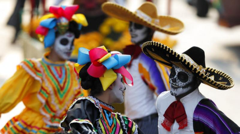 Performers participate in the Day of the Dead parade on Mexico City's main Reforma Avenue, Saturday, Oct. 28, 2017. (Photo: AP)