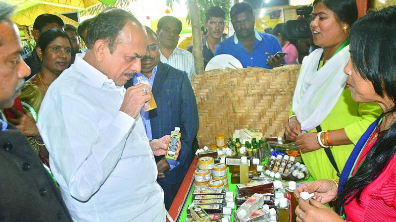 Home minister Mohammad Mahmood Ali checks out the organic products at the Women of India Organic Food Festival at Shilpramam on Wednesday. (Image DC)