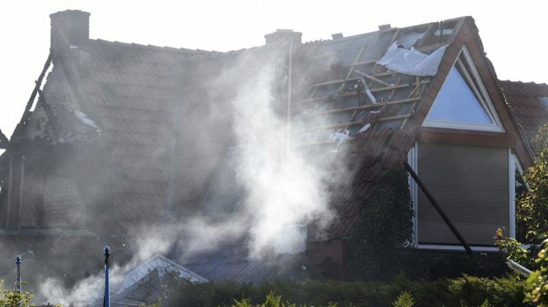 Around 70 firefighters were able to put out the blaze that followed the explosion. (Photo: AP)