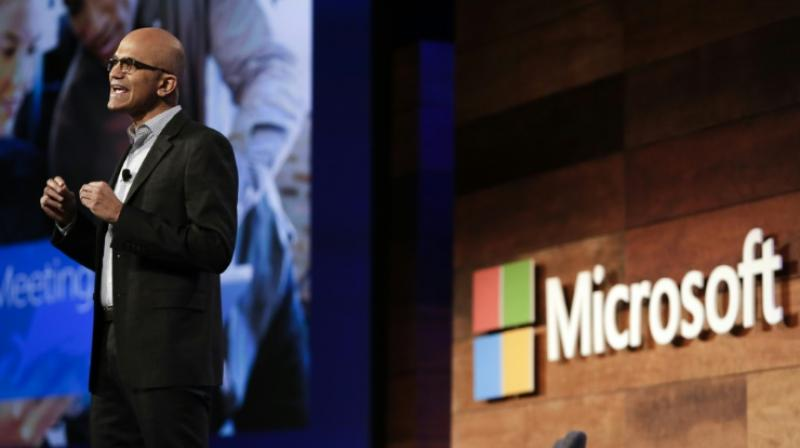 Microsoft CEO Satya Nadella, seen in 2016, is focusing the tech giant on services and Windows 10, which can integrate a variety of devices. (Photo: AFP)