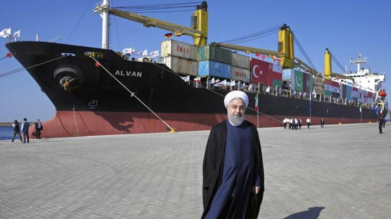Iranian President Hassan Rouhani poses during the inauguration a newly built extension of the Chabahar Port, near the Pakistani border, in southeastern Iran on Sunday. (Photo: AP)