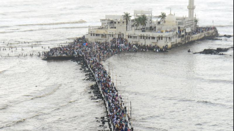 The Haji Ali Dargah saw a huge turnout of devotees on the occasion of Eid ul Fitr on Saturday. A large number of devotees visit the mausoleums of saints on Eid to pay their respects and get their wishes fulfilled. (Photo: Rajesh Jadhav)