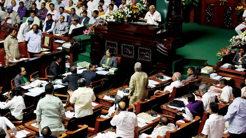 A view of the pandemonium in the state Assembly during the Budget session of the legislature at Vidhana Soudha in Bengaluru on Tuesday.