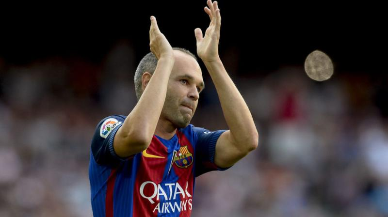 Andres Iniesta joined Barcelona's youth academy when he was 12. He went on to become one of the best players in its history, helping the team win 31 titles - a club record he shares with Lionel Messi. (Photo: AFP)