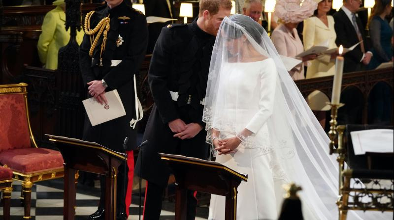 Britain's Prince Harry speaks to his bride, Meghan Markle, during their wedding ceremony at St. George's Chapel in Windsor Castle in Windsor, near London, England, Saturday, May 19, 2018. (Photo: AP)