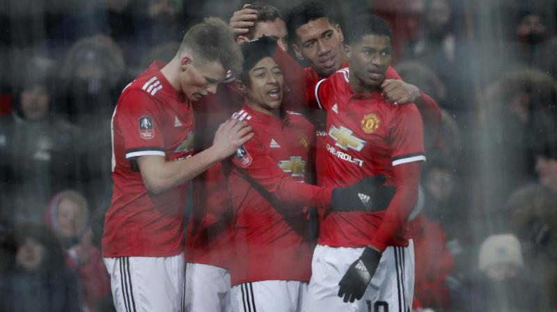 The magazine says Manchester United had nearly twice as much operating income as any other soccer team. (Photo: AP)