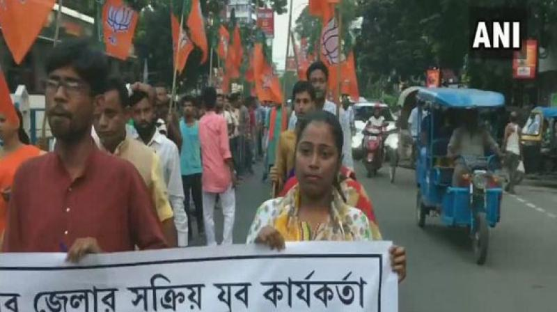 BJP Yuva Morcha workers took out a protest, on Wednesday, against the alleged killing of a 30-year-old man, who is now being claimed by both parties as their cadre. (Photo: ANI)