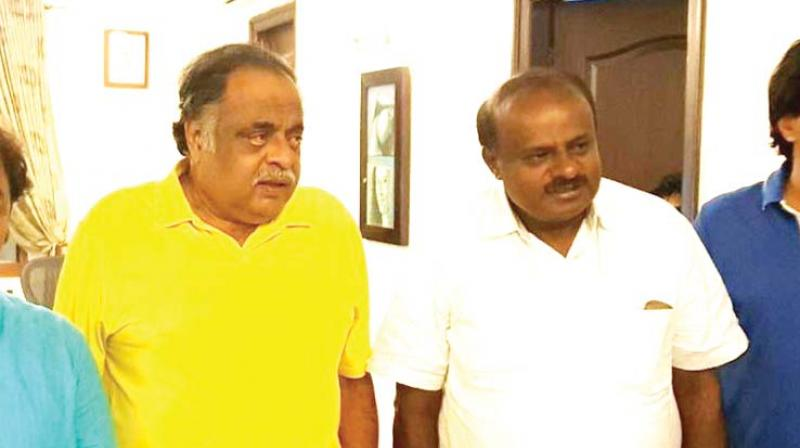Congress leader M.H. Ambarish with State JD(S) chief H.D. Kumaraswamy