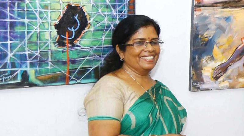 B. Jayasree near her art work