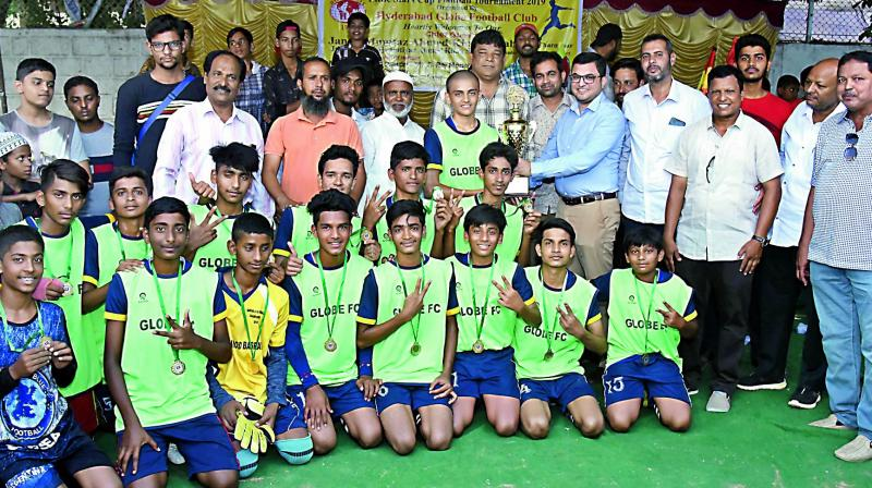 The Hyderabad Globe Under 15 team pose after winning the Little Stars Cup football tournament in Hyderabad.