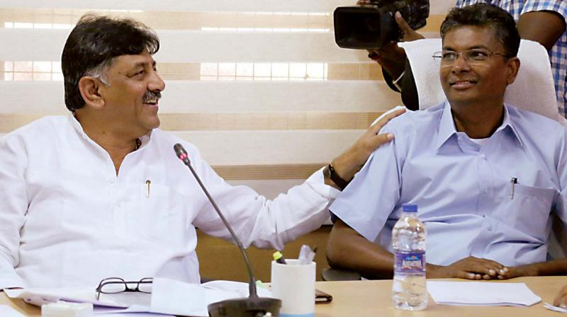 Ministers D.K. Shivakumar and Satish Jarkiholi at a meeting organised by the irrigation wing in Belagavi