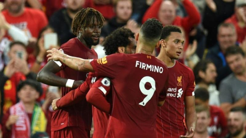 Later in the first half, Mohamed Salah, Virgil van Dijk and Divock Origi netted the ball to seal Liverpool's victory in the inaugural encounter of the Premier League. (Photo: AFP)