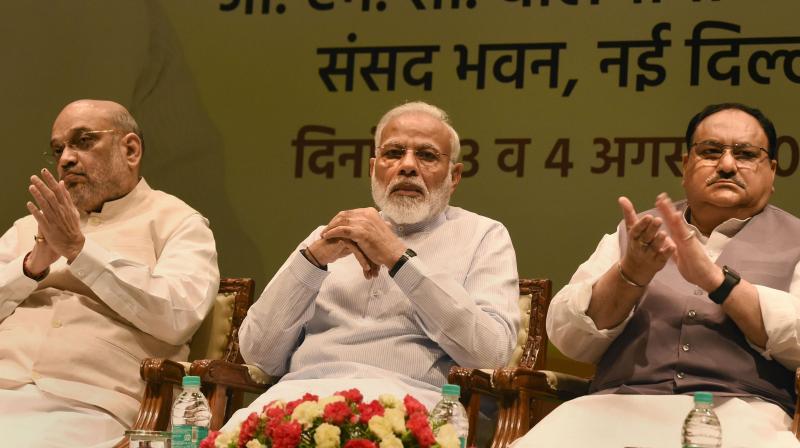 Prime Minister Narendra Modi, home minister Amit Shah and BJP working president J.P. Nadda. (Photo: PTI)