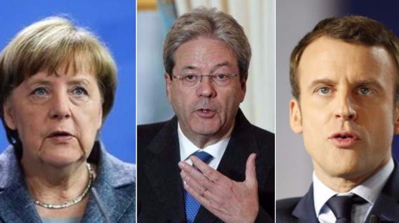 Italian Prime minister Paolo Gentiloni (center), German Chancellor Angela Merkel (left) and French President Emmanuel Macron (right) reaffirmed their strongest commitment to swiftly implement the Paris accord and urged all the other partner countries
