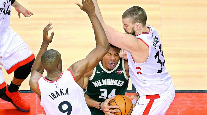 Giannis Antetokounmpo (34) of the Milwaukee Bucks handles the ball against Serge Ibaka and Marc Gasol of the Toronto Raptors during the second half in Game Four of the NBA Eastern Conference Finals in Toronto on Wednesday. (Photo: AFP)