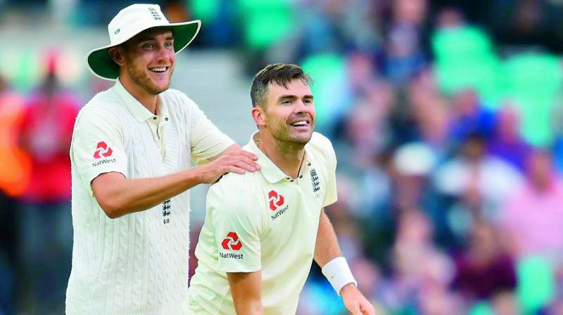 A file photo of English bowlers Jimmy Anderson (right) and Stuart Broad. (Photo: AFP)