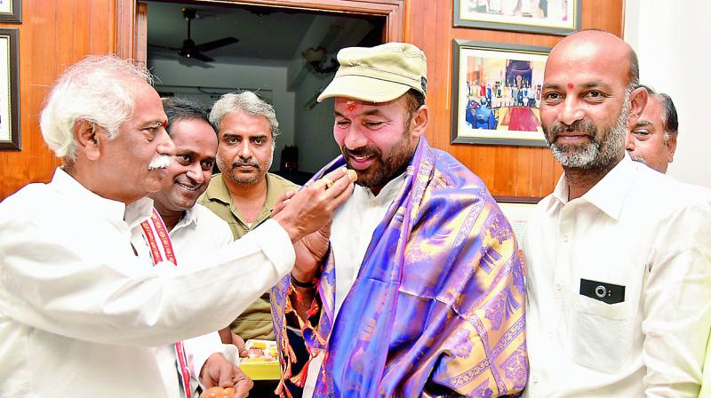 Union minister of state for home affairs and Secunderabad MP G. Kishan Reddy  meets BJP leader Bandaru Dattatreya at Ramnagar on Saturday. Karimnagar MP Bandi Sanjay was also present on the occasion.(Photo: S.Surender Reddy)