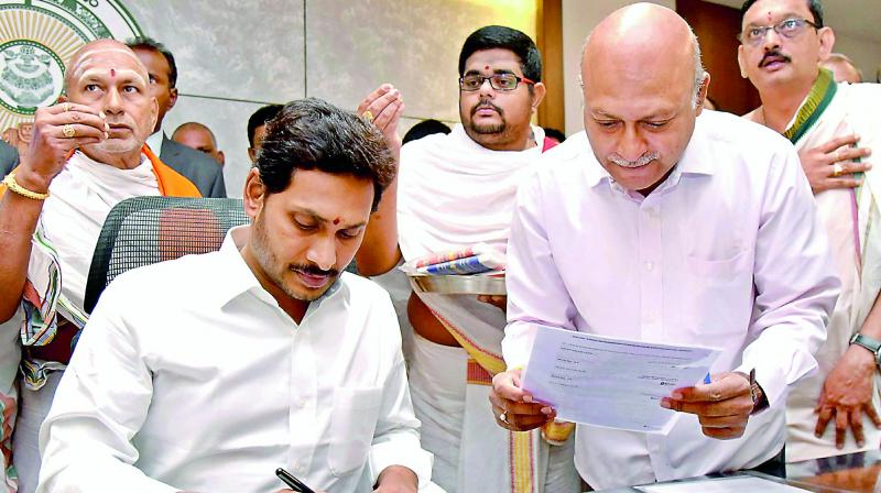 AP Chief Minister Y.S. Jagan Mohan Reddy at his office at the Secretariat in Velagapudi on Saturday. On the first day, he signed a file to increase the wages of Asha workers from Rs 3,000 to Rs 10,000.