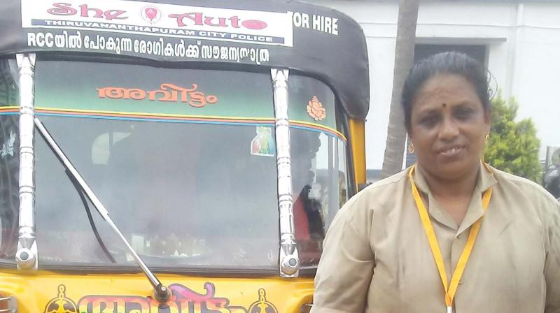 Seetha in front of her 'She- auto'