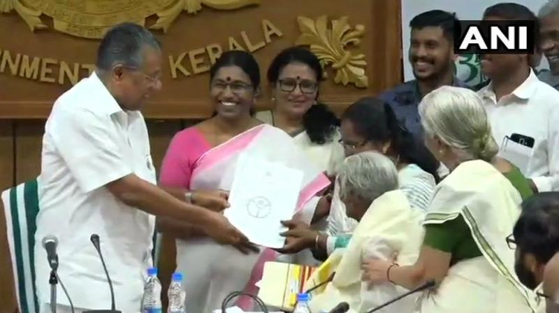 Karthiyani Amma, 96-year-old Kerala woman, who cleared test under state 'Aksharalaksham' literacy program scoring 98 out of 100 marks, was felicitated by CM Pinarayi Vijayan on Thursday. (Photo: Twitter | ANI)