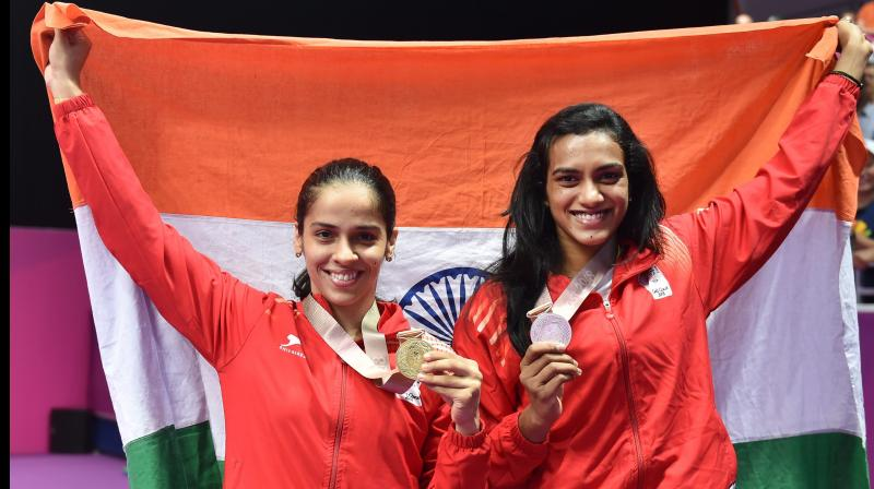 Saina Nehwal defeated her compatriot PV Sindhu by straight games in a high-octane clash to seal a 21-18, 23-21 win and clinched a gold medal in the women's singles title in the all-Indian finals of 2018 Commonwealth Games in Gold Coast, Australia on Sunday. (Photo: PTI)