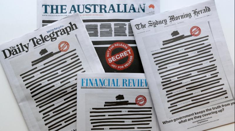 National and regional mastheads including The Australian, The Sydney Morning Herald and the Australian Financial Review hit newsstands Monday with most of their front-page news stories blacked out. (Photo: AP)