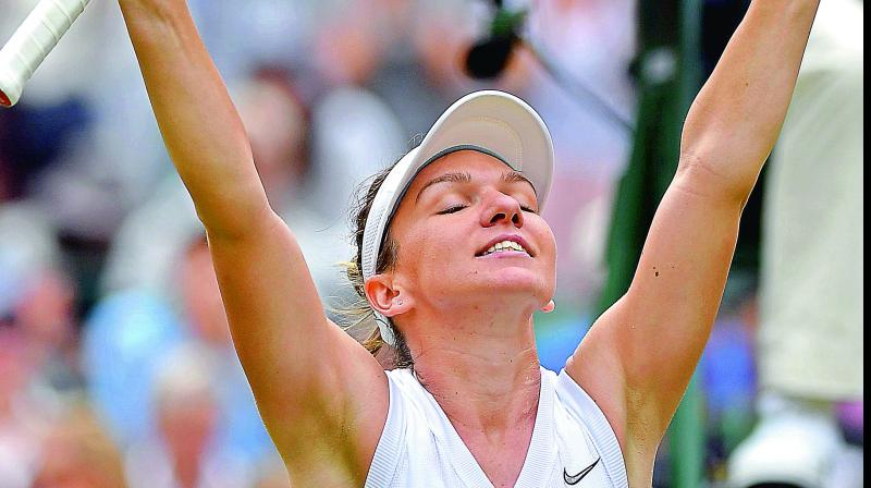 Simona Halep  celebrates after beating China's Shuai Zhang in their women's  singles quarterfinal of the Wimbledon Championships in London on Tuesday. (Photo: AFP)