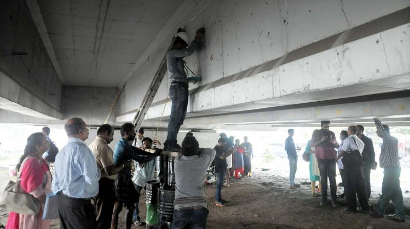 A team led by Vigilance IG H. Venkatesh inspects the Palarivattom flyover on Tuesday. (Photo: DC)